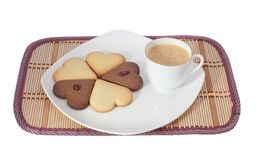 Cookies. Tasty cookies at plate closeup with coffee cup royalty free stock image