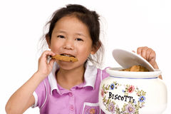 Cookies. A young girl takes a cookie from the Jar Royalty Free Stock Images