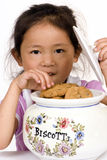 Cookies. A young girl takes a cookie from the Jar.... are you watching Stock Photography