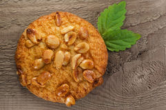 Cookies. Sweet cookies poured by nuts peanut with mint leaves stock photo
