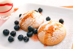 Cookies. Homemade cookies for breakfast with a glass of milk and some blueberries stock image