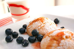 Cookies. Homemade cookies for breakfast with a glass of milk and some blueberries royalty free stock images