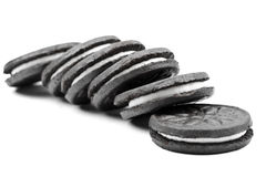 Cookies. Oreo-style cookies over a white background stock images