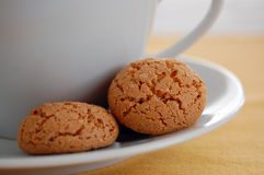 Cookies. Closeup of a cup of tea or coffee with cookies on the plate Stock Photos