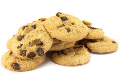Cookies. A stack of choc-chip cookies, isolated on white stock images