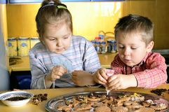 Cookies. Young girl and little boy create cookies Royalty Free Stock Photo