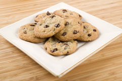 Cookies. Delicious chocolate chip cookies on a white square plate on wooden background Stock Photo