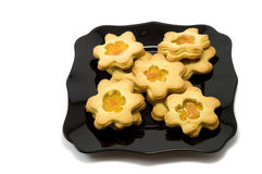 Cookies. Handmade cookies on black plate on white background Royalty Free Stock Photography