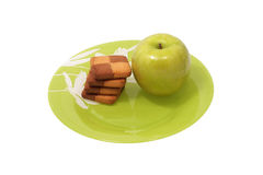 Cookies and apple on a plate. Royalty Free Stock Images