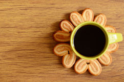 Cookies around a cup of coffee. On a wooden background Royalty Free Stock Photography