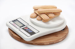 Cookies arranged on digital scale Royalty Free Stock Images