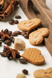 Cookies as hearts with coffee beans and spices Stock Photos