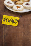 Cookies as a reward. Plate of cookies as a reward on a grunge wooden table Stock Photo