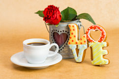 Cookies as a word love and a cup of coffee. Valentine's Day cookies as a word love and a cup of coffee and rose Royalty Free Stock Photos