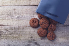 Cookies in a bag. On a wooden table Stock Photo