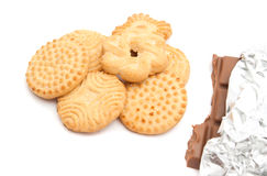 Cookies and bar of chocolate. Different cookies and bar of chocolate on white background Stock Image