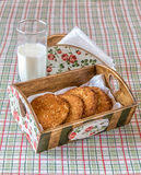 Cookies in the basket. Cookies in a basket and milk stock photos