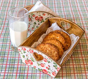 Cookies in the basket. Cookies in a basket and milk stock image