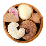 Cookies and biscuits in wooden bowl over white Royalty Free Stock Images