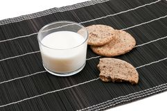 Cookies on a black backhander with a glass of milk Stock Images