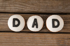 Cookies with black dad text on table. Overhead view of cookies with black dad text on wooden table Royalty Free Stock Image