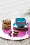 Cookies and blue mug Stock Photos