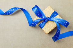 Cookies with blue ribbon Stock Photography