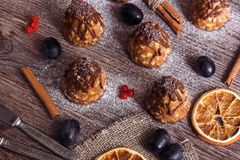 Cookies with boiled condensed milk. Cookies on a wooden table with cinnamon, berries and pelsins. Selective focus.  royalty free stock images