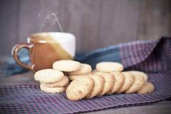 Cookies on borwn fabric Royalty Free Stock Photos