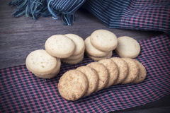 Cookies on borwn fabric Royalty Free Stock Images