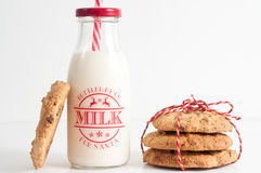 Cookies and bottle of milk for Santa. Home made cookies tied up in string and served with a bottle of milk. Ready to be left for Santa Clause Royalty Free Stock Image
