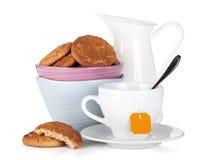 Cookies bowl, tea cup and milk jug Stock Images