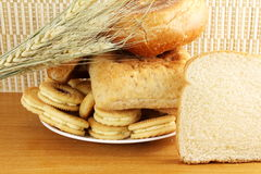 Cookies and bread in plate with wheat Royalty Free Stock Images