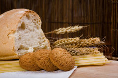 Cookies, bread and spaghetti with grain Royalty Free Stock Images