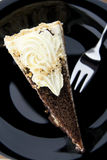 Cookies cake from above. Cookies cake with fork on a black plate Royalty Free Stock Image