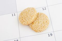 Cookies on calendar Royalty Free Stock Image