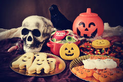 Cookies and candies on an ornamented table for Halloween Royalty Free Stock Images
