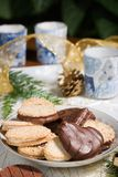 Cookies, Candles And Pine Cone On Holiday Napkin Royalty Free Stock Photos