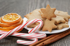 Cookies, candy canes and spices for christmas Stock Images