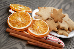 Cookies, candy canes and spices for christmas Stock Photography