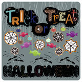 From cookies and candy. Illustration .The phrase trick or treat and halloween bats hanging from cookies and candy on a string, and the web . Picture on gray Stock Photography