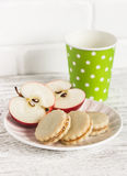 Cookies with caramel cream and walnuts, apple and a cup of milk Royalty Free Stock Image