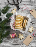 Cookies with caramel cream and walnuts in a vintage metal box, Christmas decoration and a clean, empty tag Royalty Free Stock Photography