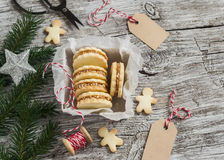 Cookies with caramel cream and walnuts in a vintage metal box, Christmas decoration and a clean, empty tag. On bright wooden surface stock photography