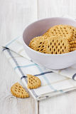 Cookies in ceramic cup. On a white surface Stock Photo