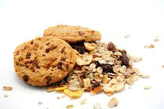 Cookies and cereals. Cookies with chocolate and muesli,cereals on white background Stock Images