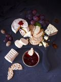 Cookies with cheese nuts jam and grapes royalty free stock photos