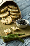 Cookies with cheese, olives and rosemary on Stock Image