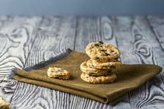 Cookies with cheese, olives and rosemary on napkin. Homemade cookies with cheese, olives and rosemary on linen napkin on wooden rustic background. Focus on stack Royalty Free Stock Photography