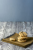 Cookies with cheese, olives and rosemary on napkin. Homemade cookies with cheese, olives and rosemary on linen napkin on wooden rustic background. Focus on stack Stock Image